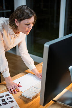 Businesswoman working on computer at her desk in the office